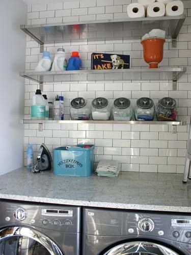 Laundry room with subway tile