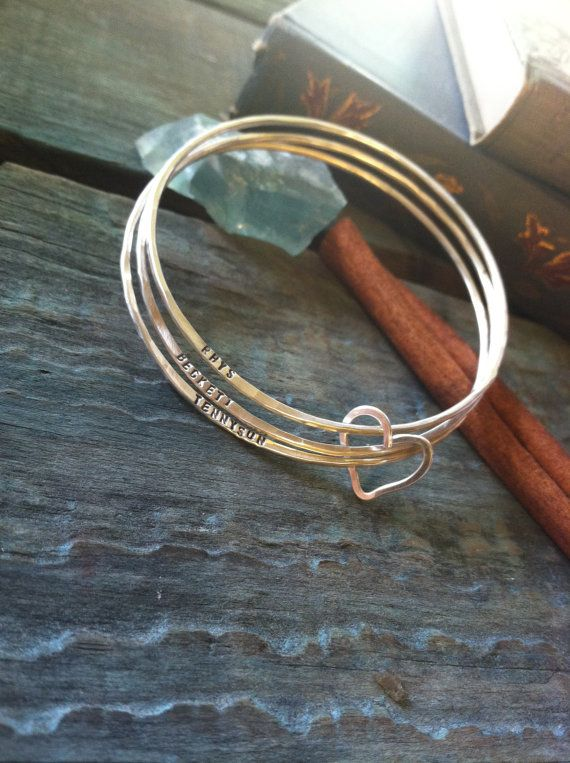 Hand stamped personalized Sterling Bangle Trio, forged and stamped bracelets with heart. $65.00, via Etsy.
