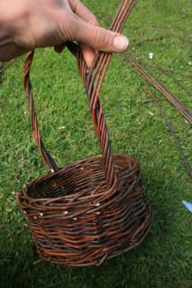 I'd love to try this sometime. Weaving a wicker basket. Looks difficult but fun.