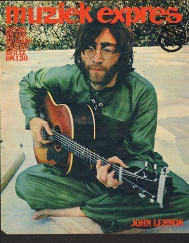 Early March 1968. John playing guitar in Rishikesh.