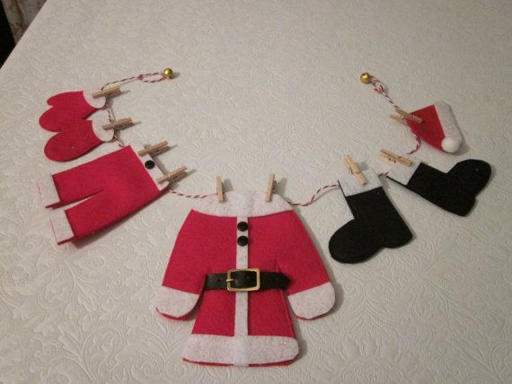 Santa needs to wash his clothes after the busy holiday season. Here is where he hangs them out to dry. Honestly! Each item is made with red, white and black felt. The clothesline in total is approximately 18 inches long. #christmas:
