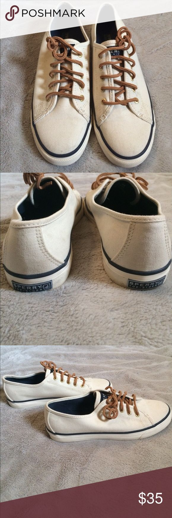 White, blue lined sneakers with brown shoelaces Slightly worn. White, blue lined sneakers with brown shoelaces Sperry Shoes Sneakers