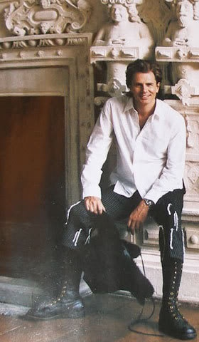 John Taylor. They appear to be Adam Ant boots on a Taylor. Very, very sly.