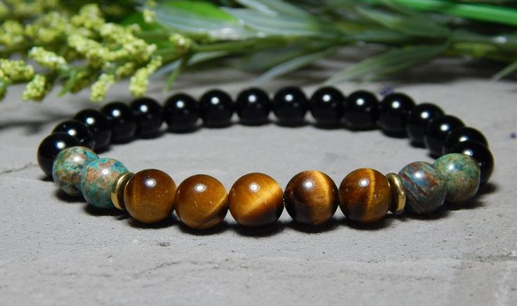 About the Bracelet This mens gemstone bracelet is a unique combination of gemstones and colors. This dynamic and earthy bracelet is a great addition to your wardrobe. Bracelet Details: This mens brace