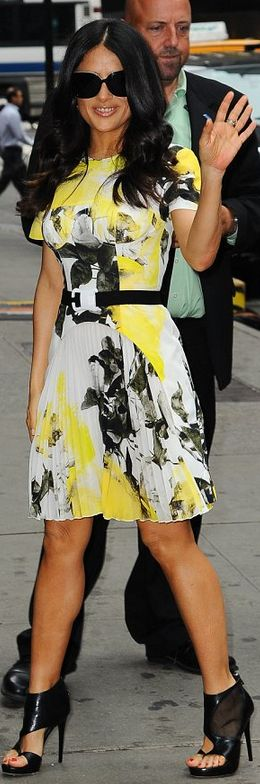 Who made  Salma Hayek's white, black and yellow floral pleated dress that she wore in New York?