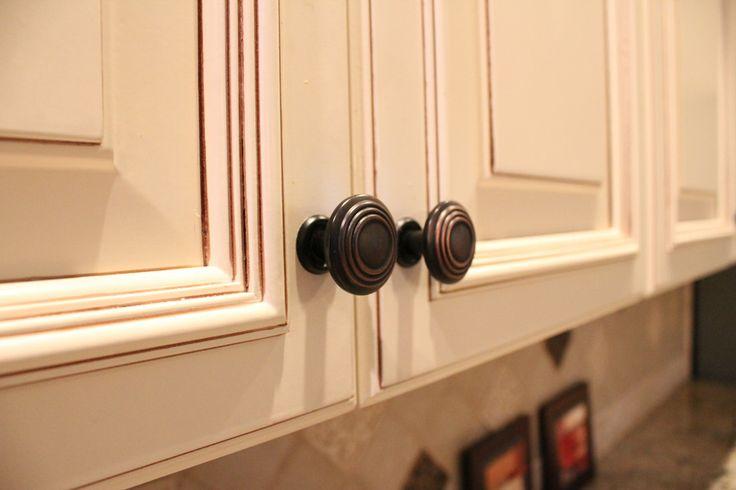 Ivory cabinet finish with glaze, dark bronze hardware pull ...