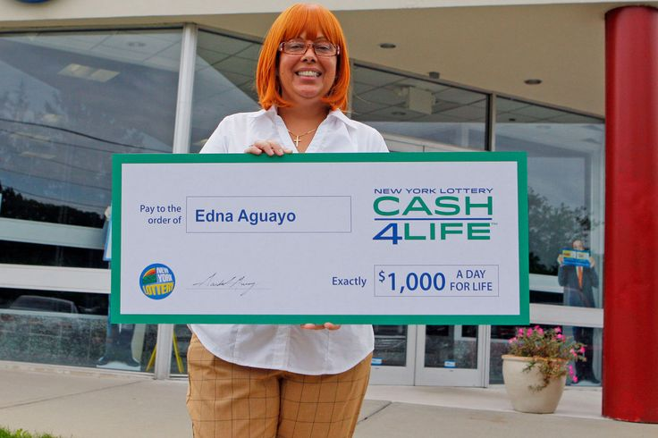Edna Aguayo, who won $1,000 a day for the rest of her life through New York Lottery's Cash4Life game, said a psychic told her long ago she'd hit it big one day.  #psychic #psychicpredictions #psychicwinslottery