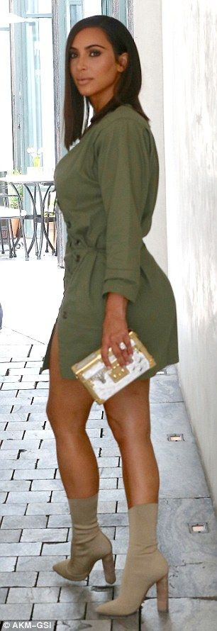 New Hairstyle? Kim Kardashian West's new haircut on show with husband Kanye West. Kim looks super hot in the green laced dress and boots. Kim's look was complete with nude ankle boots and a metallic box clutch