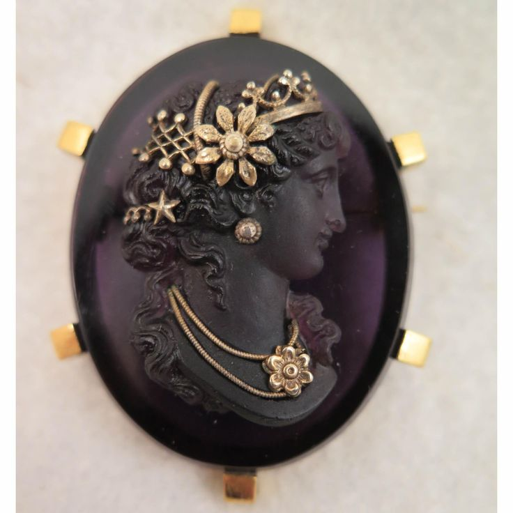 This is a breathtaking Victorian period pâte de verre amethyst glass cameo brooch in gold tone pinchbeck setting and with crown, headdress, earrings