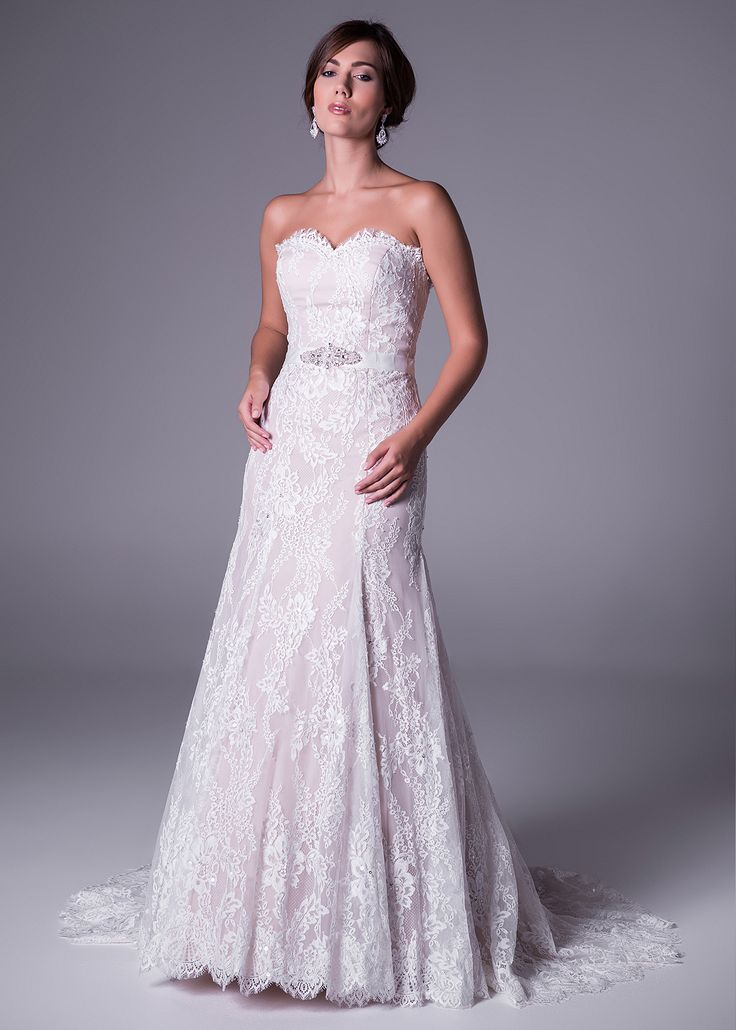 Lovely in lace! Two-tone lace wedding gown with bearded belt detail by Oleg Cassini - available exclusively at Bride&co in champagne and ivory colours (style: WPD16608). Click to book a fitting now.