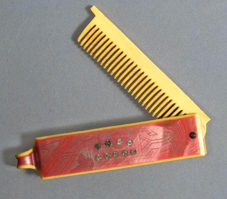 Make all your accessories match! This pink and yellow art deco folding comb was made around 1925.