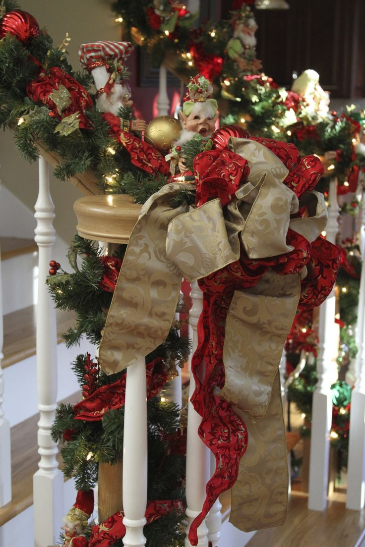 Decorated Christmas Stairs With Ribbon Garland And Mark
