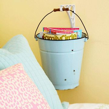 such a cute idea if there is no room for a nightstand or even over one! great for a notebook, magazines, books etc and you can totally keep it for a kids room like this or use a plain silver one or paint it to match your own bedroom with pattern or anthign! the possibilities are endless! oooo picture it on a back porch next to a swing or bench too!