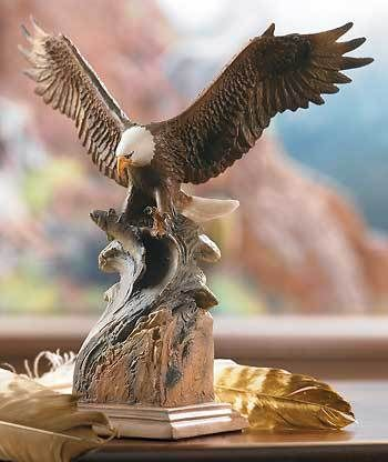 Feel the power and beauty of the Bald Eagle as it swoops down and snatches a fish out of the water. This scupture is a wonderful piece of wildlife decor that will add a touch of the great outdoors to