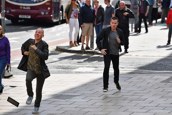 Ewan McGregor Photos Photos - Actors Ewan McGregor and Ewan Bremner run on the set of the Trainspotting film sequel on Princess Street on July 13, 2016 in Edinburgh, Scotland. The long awaited Trainspotting 2 is being filmed in Edinburgh and Glasgow, 20 years after the original was released and it will also see the cast from the first film returning including Ewan McGregor, Jonny Lee Miller and Robert Carlyle. - Filming Begins on 'Trainspotting 2'