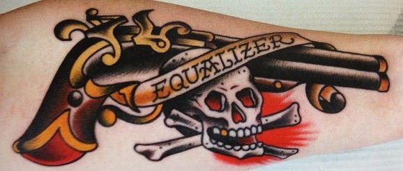 Old school flintlock skull tattoo