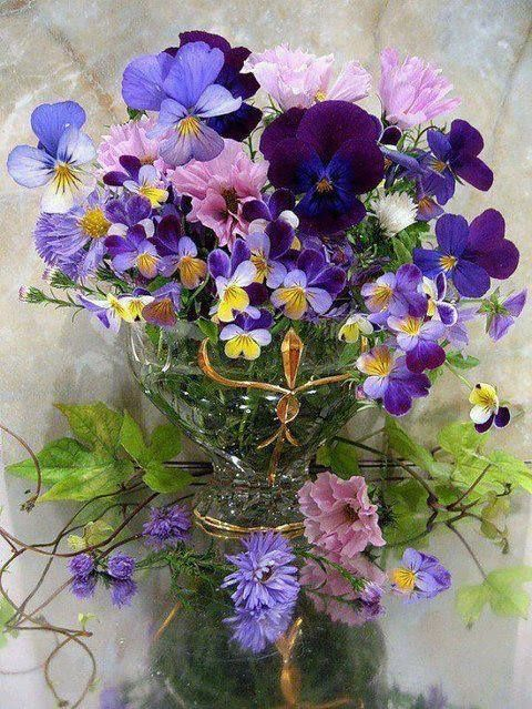 Gathering a little bunch of Pansies, Johnny-Jump-Ups, Asparagus Fern, etc. can be breathtakingly beautiful in a simple jam jar.