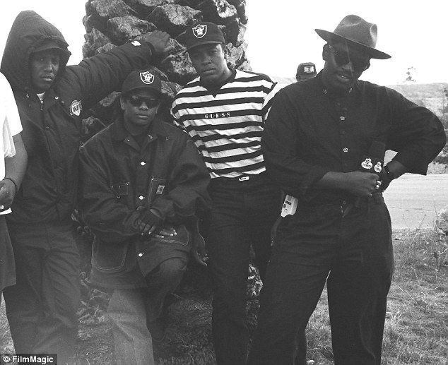 Rap legends: Dr. Dre is shown in the striped shirt with NWA members MC Ren and Eazy E and ...