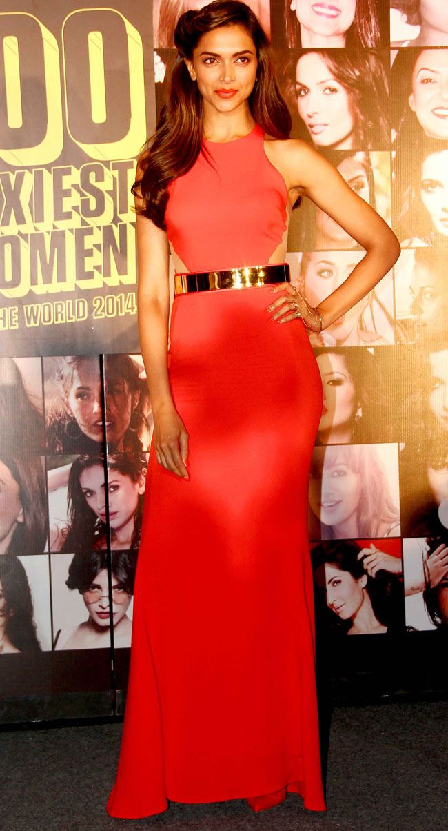 Deepika Padukone strikes a pose for shutterbugs at FHM '100 Sexiest Women in the World 2014' bash. #Style #Bollywood #Fashion #Beauty #Sexy