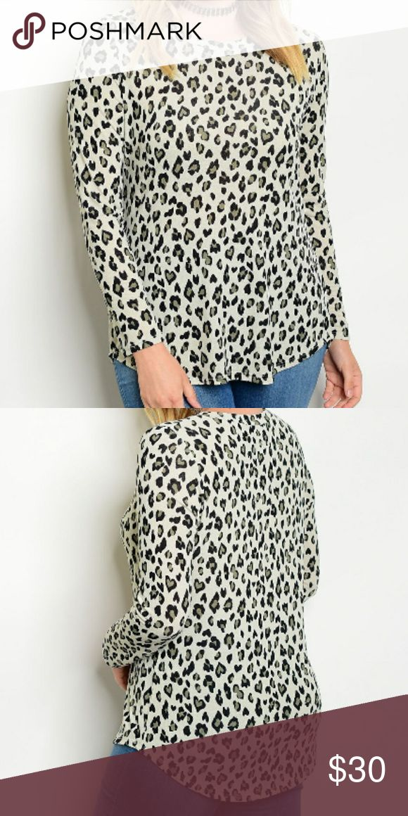 1XL Animal Print Crew Neck Plus Size Tee Ivory, tan, and black animal print long sleeve top.  95% Polyester, 5% Spandex.  Offers and questions are encouraged! banabee Tops Tees - Long Sleeve