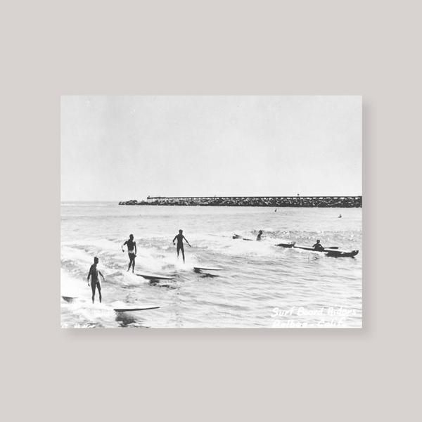 Anewall features this fun, retro black and white photograph of surfers from the Tom Pully collection, shot at Corona del Mar and circa 1950's. This old-school matte finish print comes in six sizes and is available unframed or framed with a choice of six different styles.