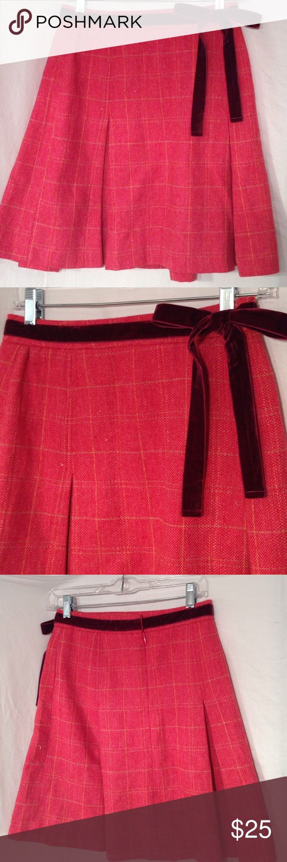 "Downeast Basics pleated skirt Size XXS Super cute pleated skirt with burgundy velvet ribbon and hidden zipper in the back.  Skirt is an orangish red color with pale blue and yellow plaid stripes running through it.  70% cotton 30% wool.  Waist is approx 27"", length is 19.5"". Downeast Basics Skirts"