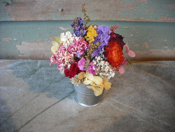 Tiny colorful dried flower arrangement in little tin bucket, nice favor for your wedding or special event.