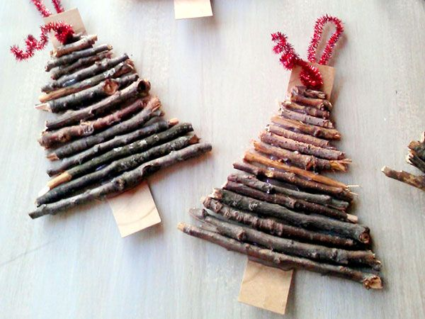 Bake a handful of kindling or twigs—to get rid of any bugs—then chop it up to put together some tiny trees to hang on your big tree. Check out the steps on @amystowandtellu