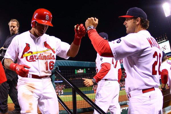 Mike Matheny Photos - Kolten Wong #16 of the St. Louis Cardinals is congratulated by manager Mike Matheny #26 of the St. Louis Cardinals after hitting the game-winning home run against the Detroit Tigers in the sixth inning at Busch Stadium on May 17, 2015 in St. Louis, Missouri. - Detroit Tigers v St Louis Cardinals