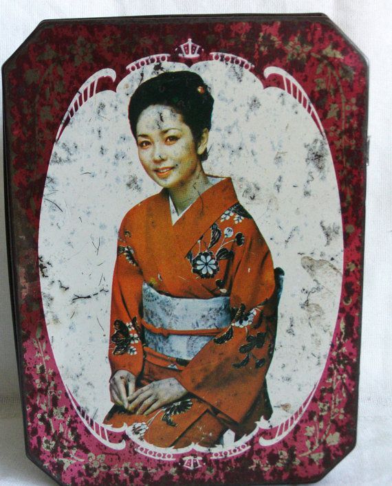 Vintage tin box for featuring a beautiful geisha. Japanese lady is sitting and smiling, she is wearing a traditional red kimono and white obi. Lid