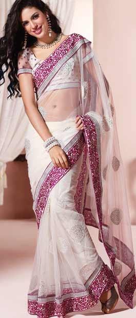 Off White Net Saree with Blouse    Itemcode: SDW1311    Price: US $68.02    Click @ http://www.utsavfashion.com/store/sarees-large.aspx?icode=sdw1311