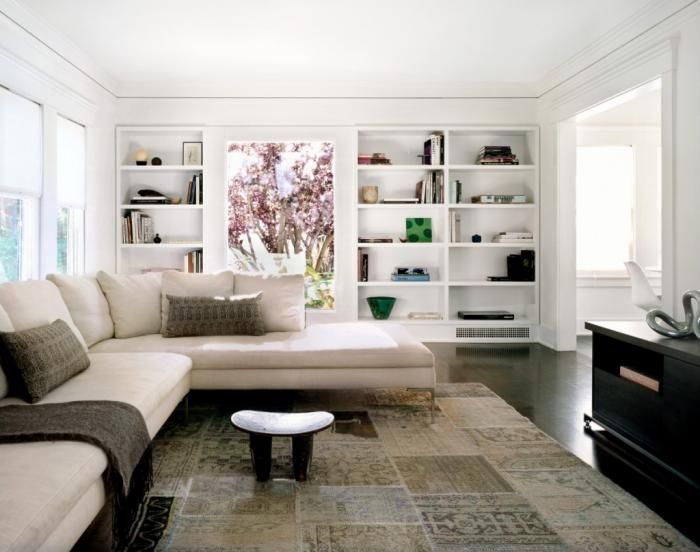 Built ins surrounding a large picture window -- Photography by Catherine Tighe