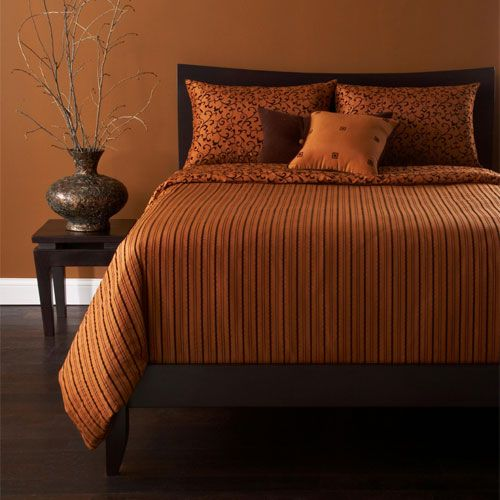 Combine copper orange walls with dark wood for a warm for Burnt orange bedroom ideas