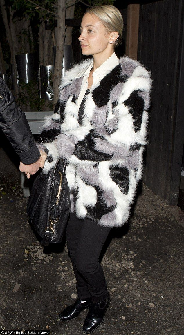 Partying: Nicole Richie opted for monochrome style when she stepped out in Los Angeles on Saturday night