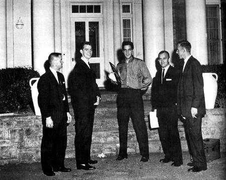 In october 24 1960 The Tau Kappa Epsilon fraternity at Arkansas State College presenting Elvis with a Man of the Year Award for his considerable contributions to charity.
