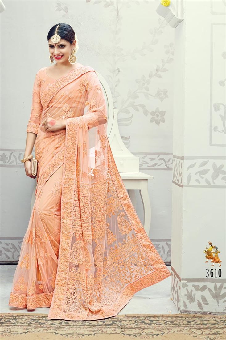 Online Shopping of Fabulous Peach Color Net Wedding Wear Saree from SareesBazaar, leading online ethnic clothing store  offering  latest collection of sarees, salwar suits, lehengas & kurtis