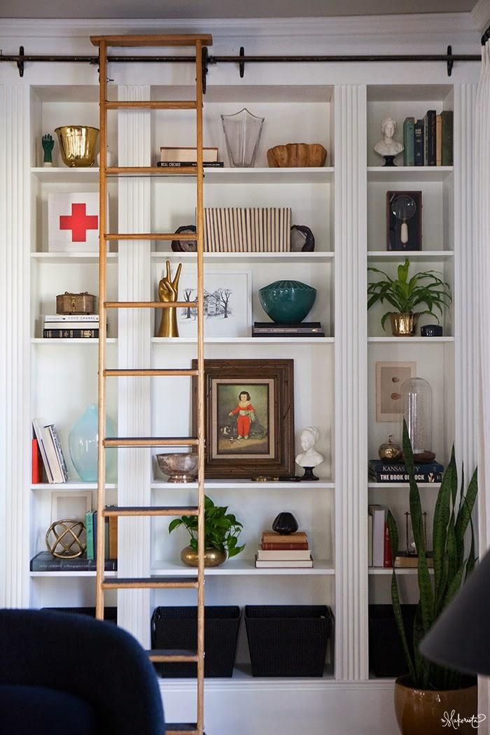 We still can't believe this glam home library (complete with rolling ladder!) was fashioned from three Ikea bookcases. #DIY