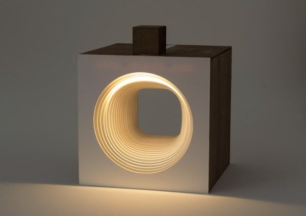 Magnetic cube slides to move a strip of light.  Panta Rei Light Cube-circle
