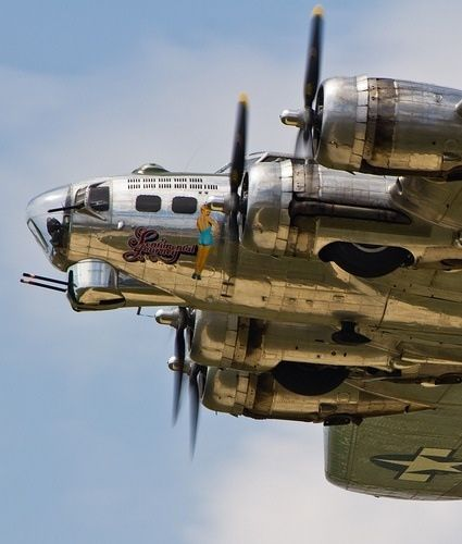 "The beautifully restored ""Sentimental Journey"" B-17 flies overhead at the Thunder Over Michigan Airshow."