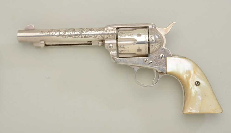 """For comparison, here's the Colt Single Action Army """"Peacemaker"""" revolver, .38-40 cal.,  5-1/2 barrel, factory engraved, Mother-of-Pearl grips.  Nice."""