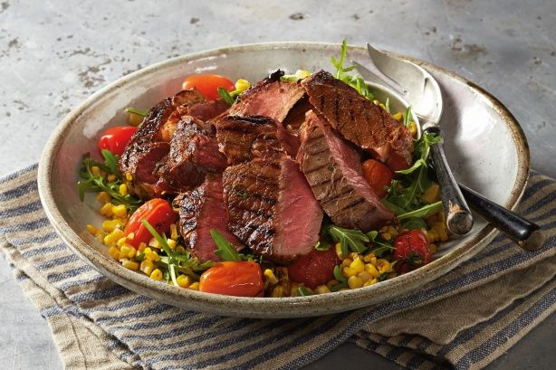 Get dinner sorted fast with Curtis Stone's sensational soy and maple scotch fillet with grilled corn and tomato salad.