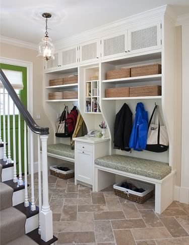 stairs in middle with mudroom on one side and utilities on the other