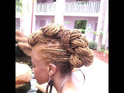 Twisted Faux Mohawk...I'm going to pinch the very back twist together and pinned them down so they don't look separated.