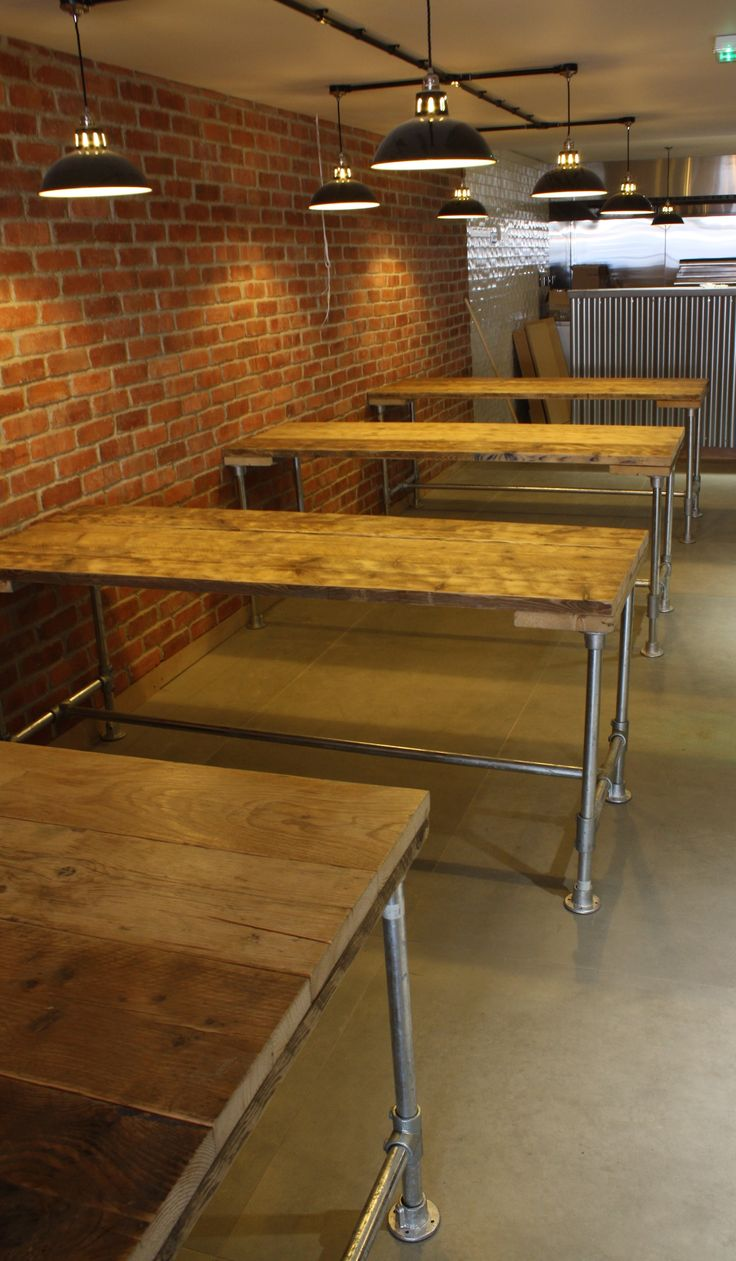 Some of the reclaimed scaffold boards tables on scaffold pole frames that we…