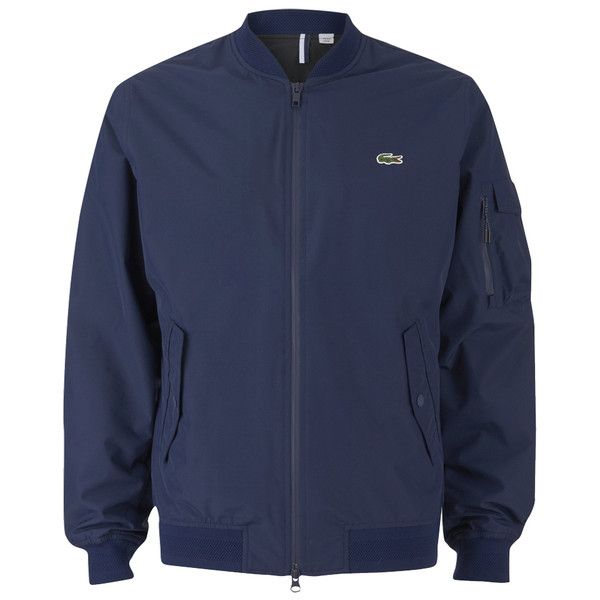 Lacoste Men's Zipped Bomber Jacket (21595 RSD) ❤ liked on Polyvore featuring men's fashion, men's clothing, men's outerwear, men's jackets, blue, mens blouson jacket, mens blue jacket, mens flight jacket and mens navy bomber jacket