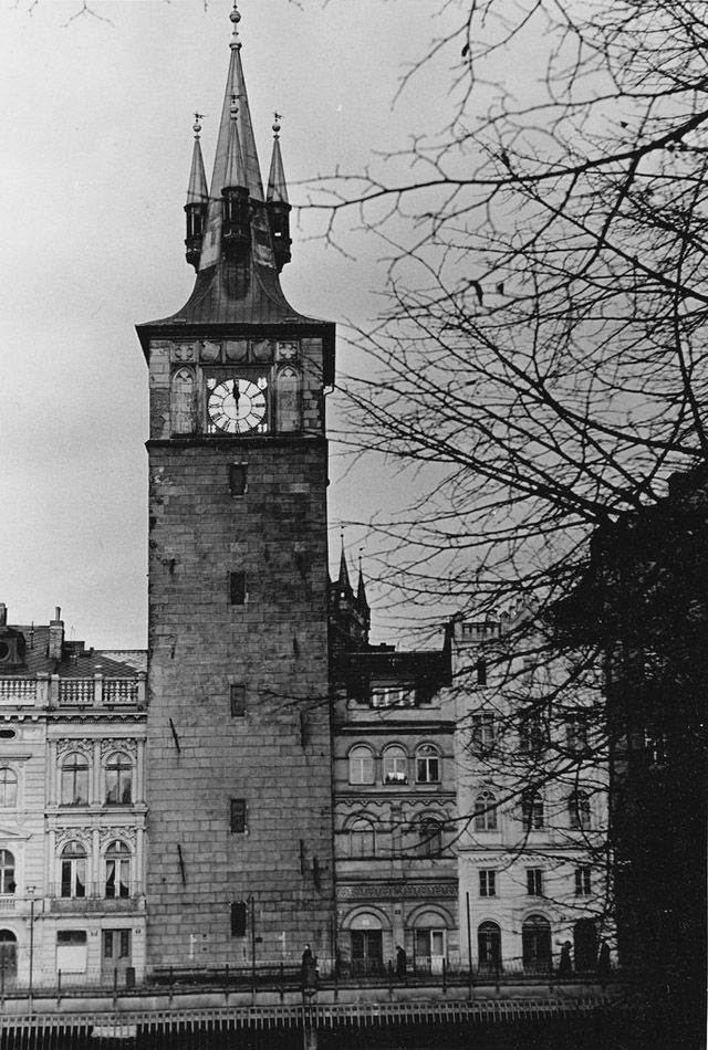 Black and white photos show everyday life of Prague in the 1950s.