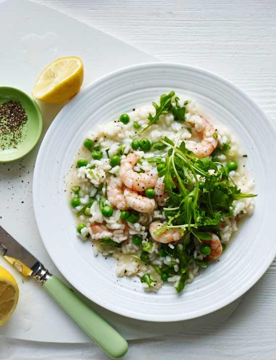 Oven-baked prawn, pea and rocket risotto. Delicious Italian rice recipe with seafood.