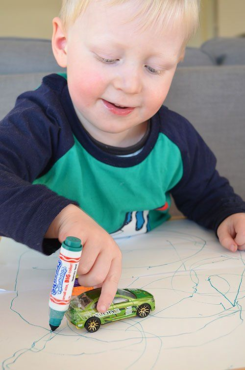 Childhood 101 | 6 Ways to Play with Toy Cars: attach marker and drive to make art