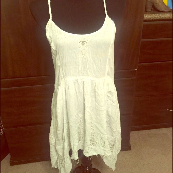 FREE PEOPLE White Dress Intimately Collection. ✨NWT✨ FREE PEOPLE INTIMATELY COLLECTION.  It says it's part of the intimate collection, however it can be worn as a dress or a swim cover up. It has nice thick material. Free People Dresses Asymmetrical