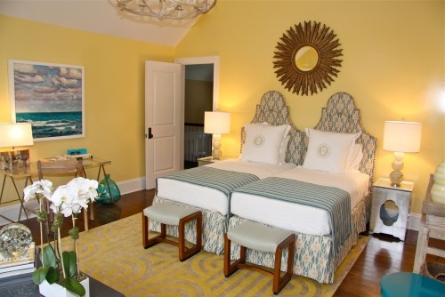 In a small guest room or a small wall, push two twin beds together.  Each person gets their own bed and economize space too.  Like the shape of the headboard.  Looks pulled together.  Hmmm...